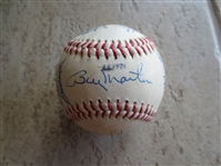 Autographed baseball with 19 signatures including Billy Martin