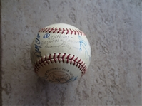 Autographed baseball with 22 signatures including Pete Rose and Walter OMalley